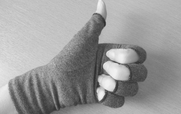 Featured Images - Grey compression gloves on a hand in thumbs up