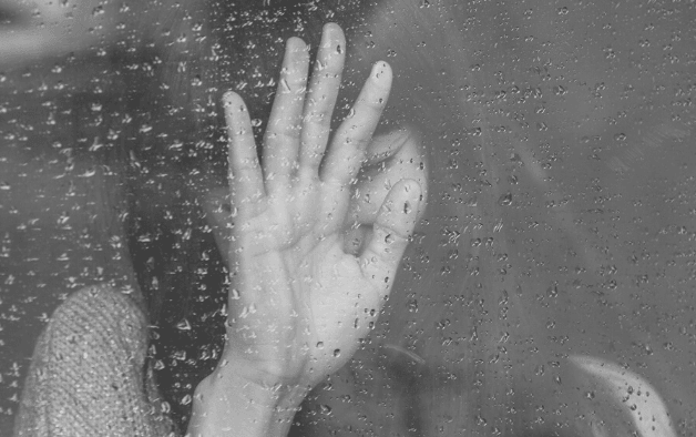 Featured Images - Woman resting her hand against a rain covered window. Image from Pixabay