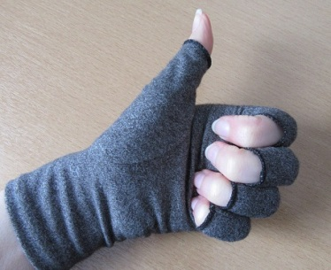 Photo of hand in thumbs up wearing a Duerer Compression Glove