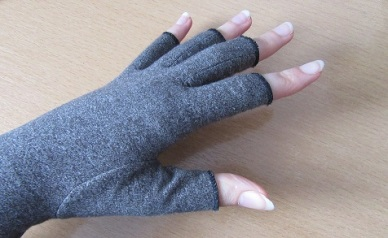 Photo of a hand wearing the grey Duerer Compression Glove