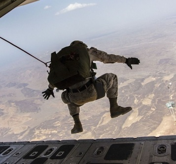 Photo of an serviceman jumping out of a plane in a skydive. Image from Pixabay by Skeeze