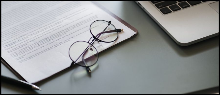 Image of laptop, contract and glasses
