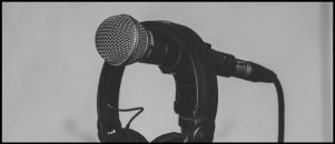 Podcast Page: Image of a microphone and headphones