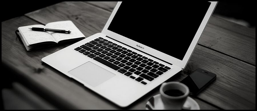 Blogger Series. Image of a laptop, pad and a coffee